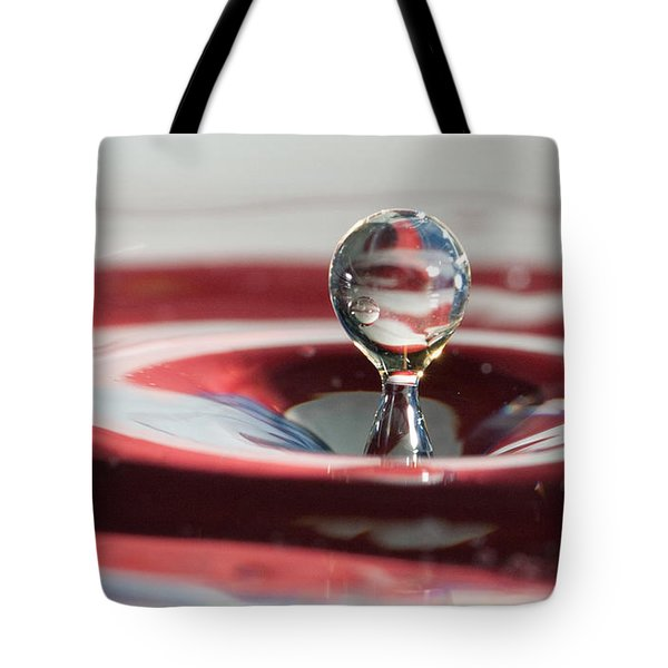 Water Drops Jumping Tote Bag by Jeff Folger