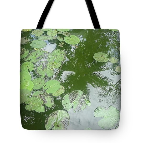 Water Lily Leaves And Palm Trees Tote Bag by Nora Boghossian