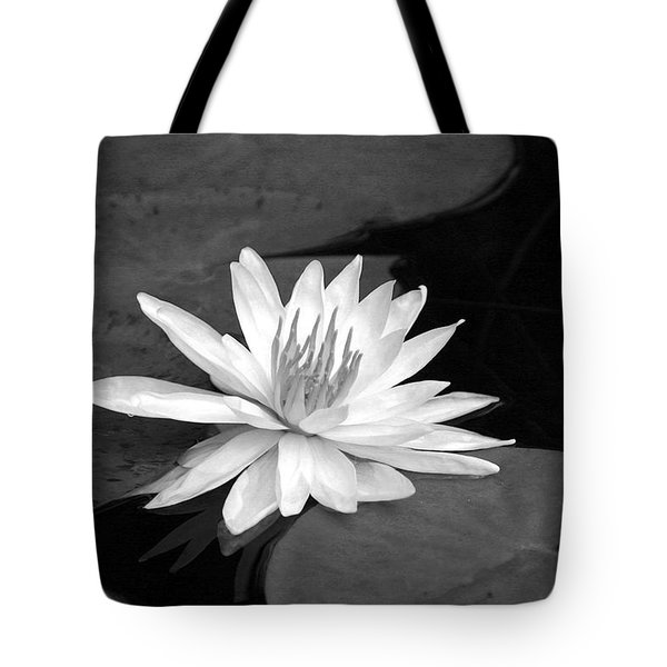 Tote Bag featuring the photograph Water Lily On Pad by Phil Mancuso