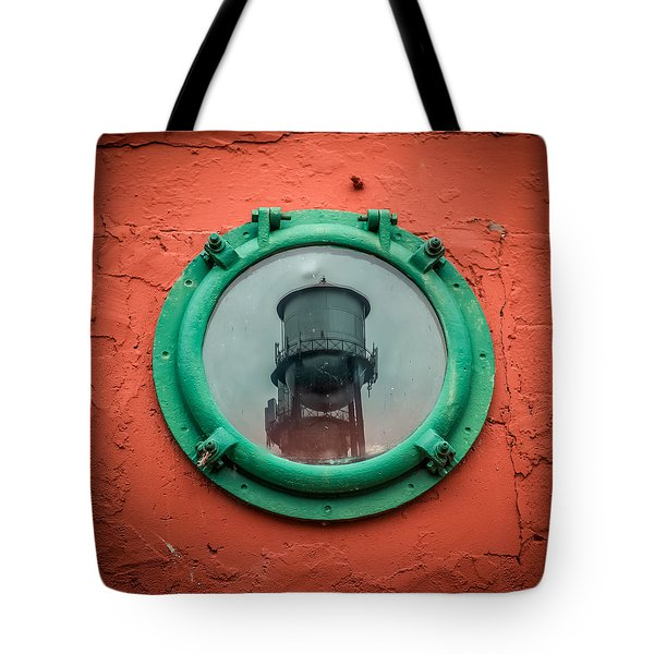 Water Tower Reflection Tote Bag by Paul Freidlund