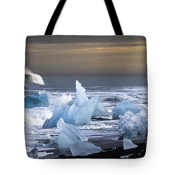 Tote Bag featuring the photograph Water Versus Ice by Gunnar Orn Arnason