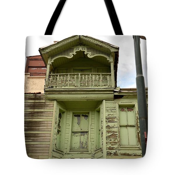 Tote Bag featuring the photograph Weathered Old Green Wooden House by Imran Ahmed