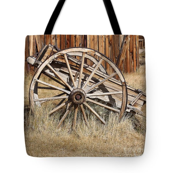 Tote Bag featuring the photograph Weathered Wagon by Art Block Collections