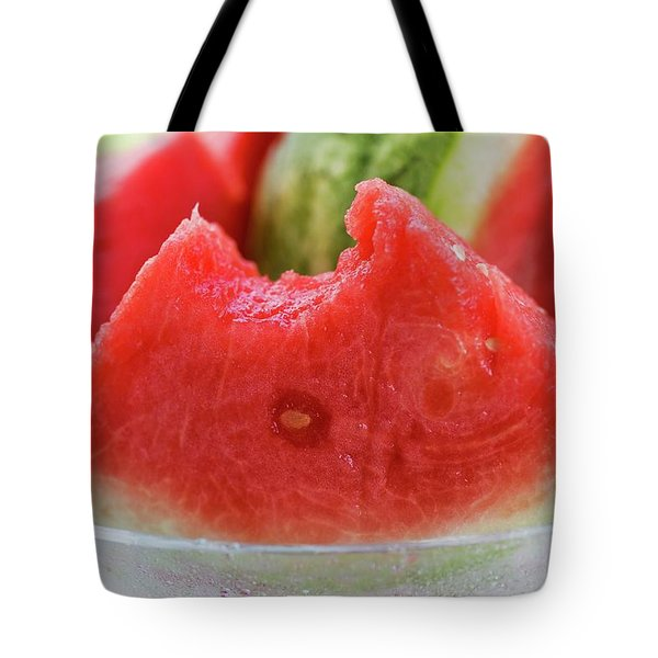 Wedge Of Watermelon, A Bite Taken, In A Glass Bowl Tote Bag