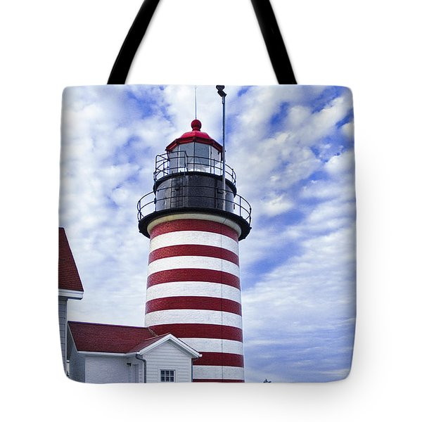 West Quoddy Head Lighthouse And Clouds Tote Bag by Marty Saccone