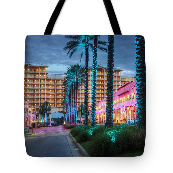 Tote Bag featuring the photograph Wharf Blue Lighted Trees by Michael Thomas
