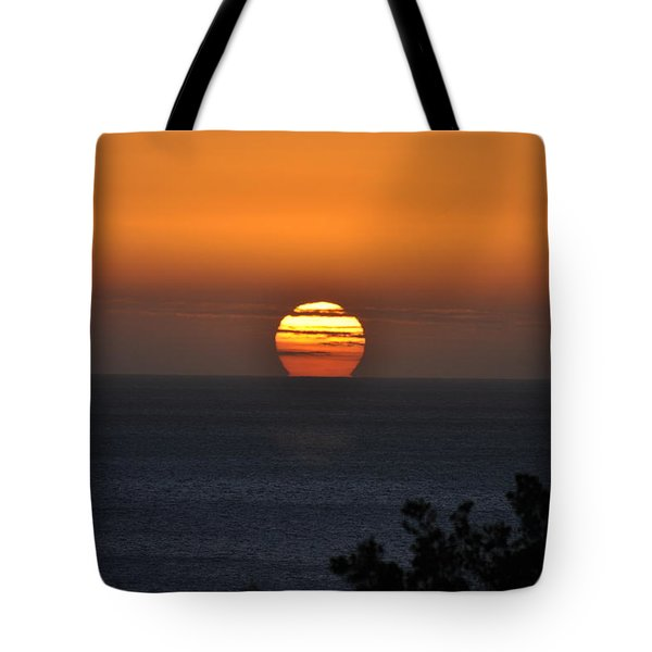 Tote Bag featuring the photograph When The Sun Sets by Sabine Edrissi