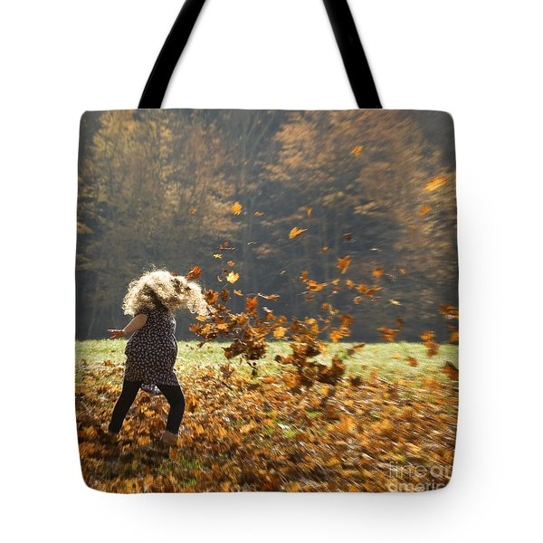 Tote Bag featuring the photograph Whirling With Leaves by Carol Lynn Coronios