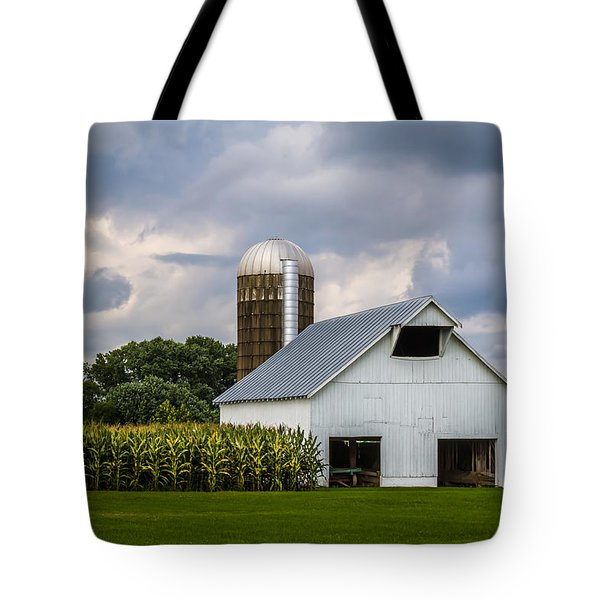 White Barn And Silo With Storm Clouds Tote Bag