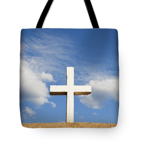 Tote Bag featuring the photograph White Cross On Adobe Wall by Bryan Mullennix