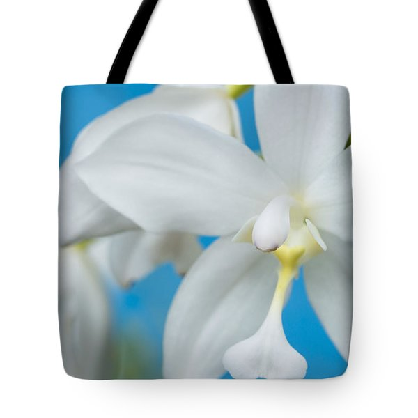 Tote Bag featuring the photograph White Orchid by Leigh Anne Meeks