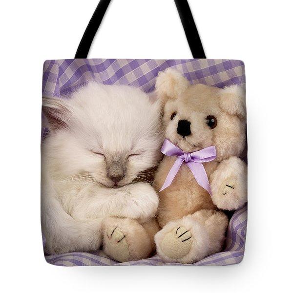 White Sleeping Cat Tote Bag by Greg Cuddiford