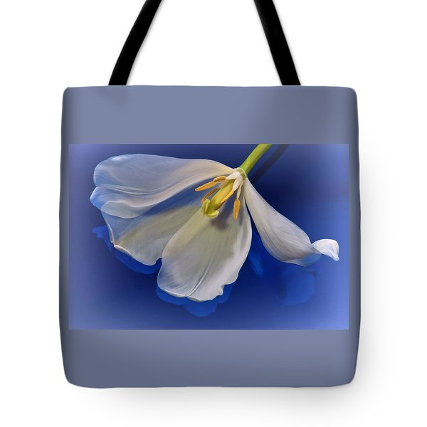 White Tulip On Blue Tote Bag
