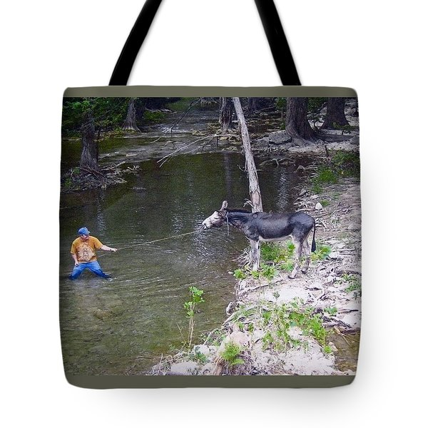 Tote Bag featuring the photograph Who Is More Stubborn by John Glass