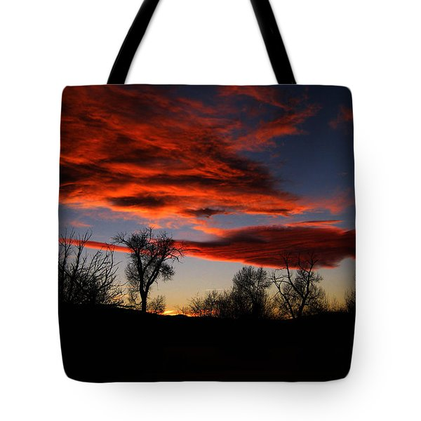 Tote Bag featuring the photograph Wicked Skies by Janice Westerberg