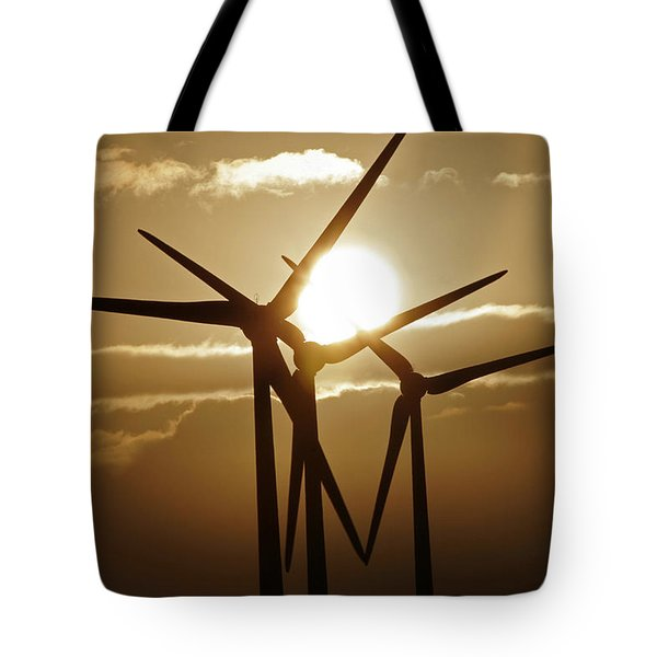 Wind Turbines Silhouette Against A Sunset Tote Bag