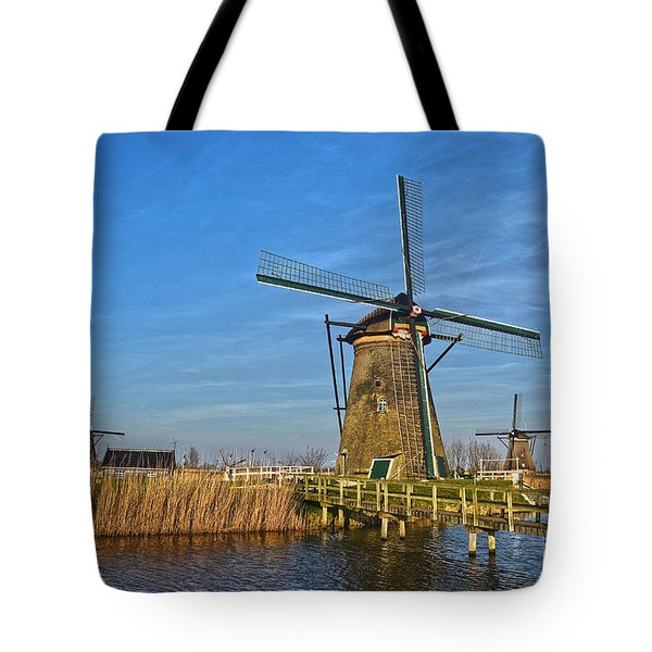 Tote Bag featuring the photograph Windmills And Bridge Near Kinderdijk by Frans Blok