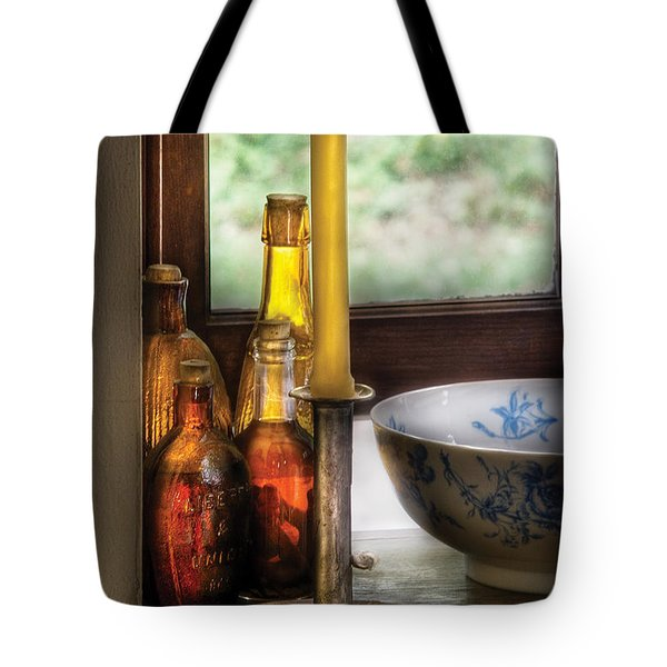 Wine - Nestled In A Corner Of A Window Sill  Tote Bag by Mike Savad