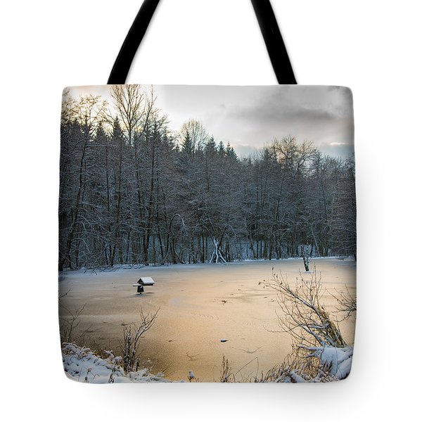 Winter Landscape With Frozen Lake And Warm Evening Twilight Tote Bag by Matthias Hauser