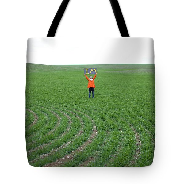 Woman In Big Field Holds Up Sign Tote Bag