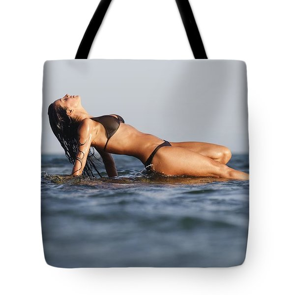 Woman Lying On The Water Tote Bag