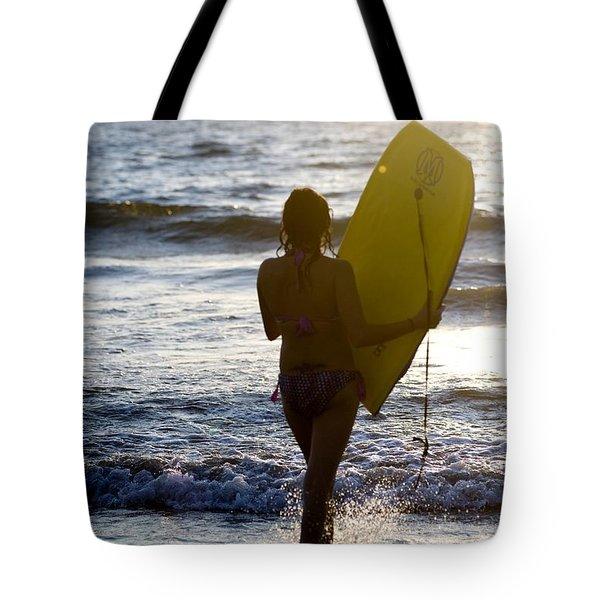 Woman On Beach Carrying Bodyboard Tote Bag