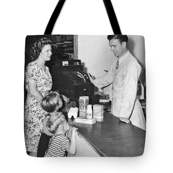 Woman Purchasing Groceries Tote Bag by Underwood Archives