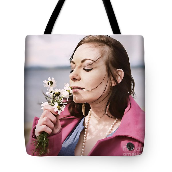 Woman Scenting Daisies Tote Bag