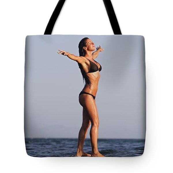 Woman Standing On The Water Tote Bag