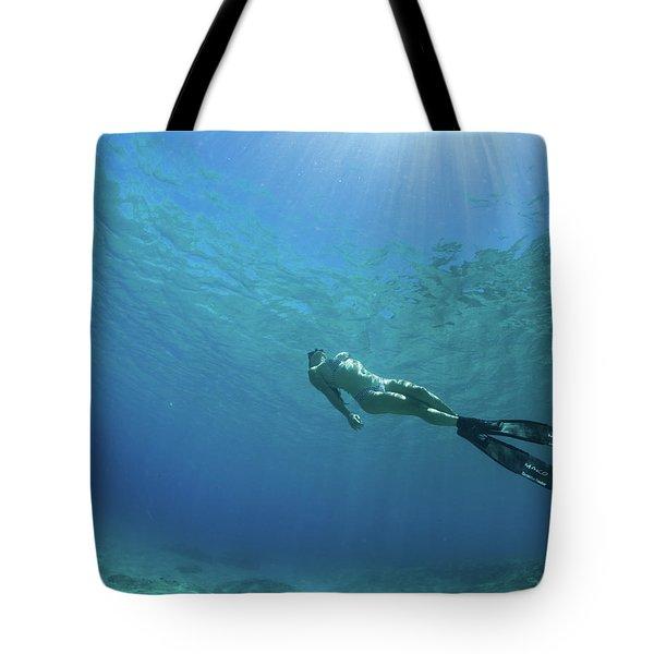 Woman Swimming In Pacific Ocean Tote Bag