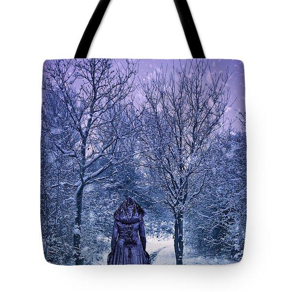 Woman Walking In Snow Tote Bag by Amanda Elwell