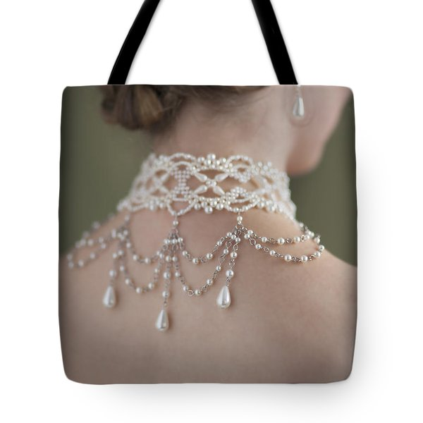 Woman Wearing A Pearl Necklace And Earring Set Tote Bag by Lee Avison