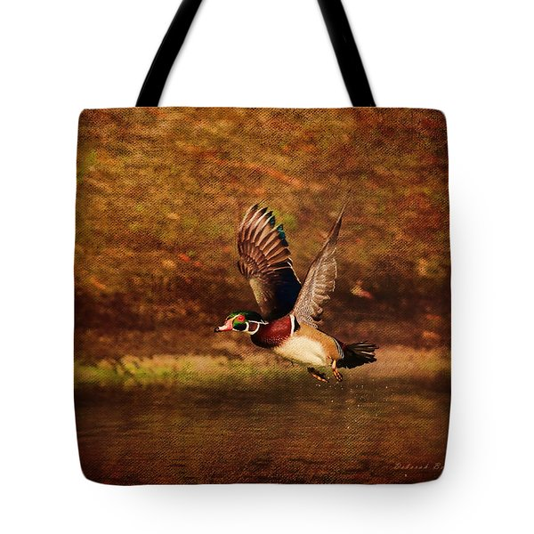 Wood Duck Taking Off Tote Bag by Deborah Benoit