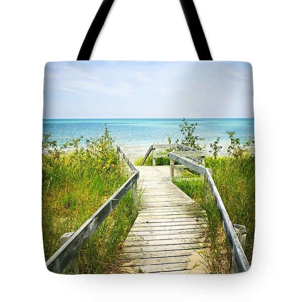 Wooden Walkway Over Dunes At Beach Tote Bag by Elena Elisseeva