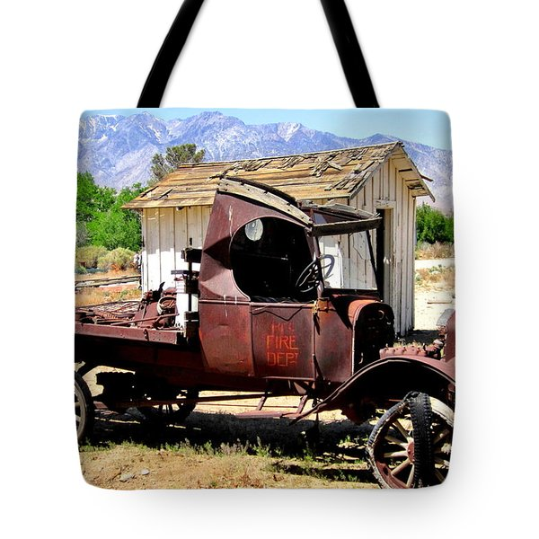 Tote Bag featuring the photograph Work Needed by Marilyn Diaz