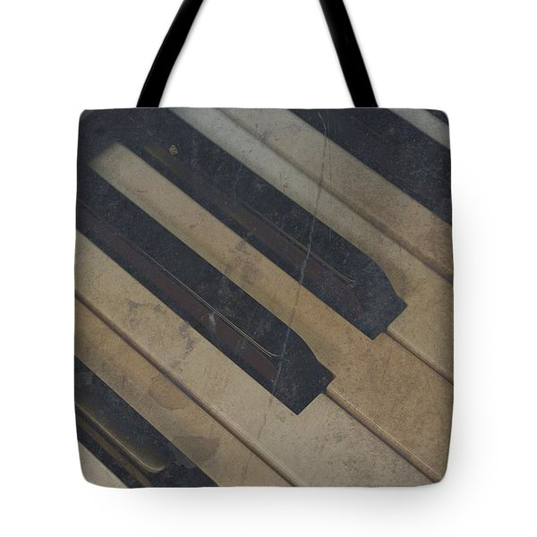 Tote Bag featuring the photograph Worn Out Keys by Photographic Arts And Design Studio