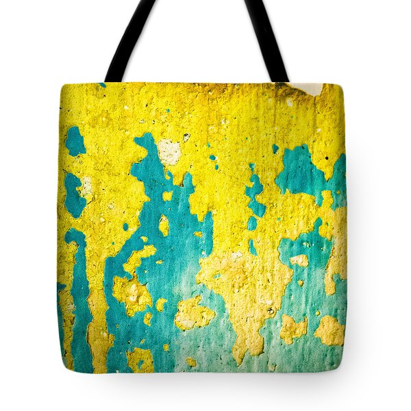 Tote Bag featuring the photograph Yellow And Green Abstract Wall by Silvia Ganora