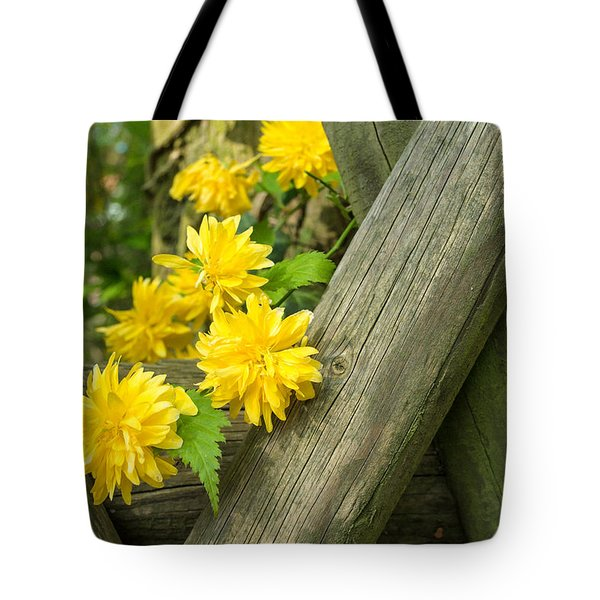 Yellow Flowers And Fence Tote Bag