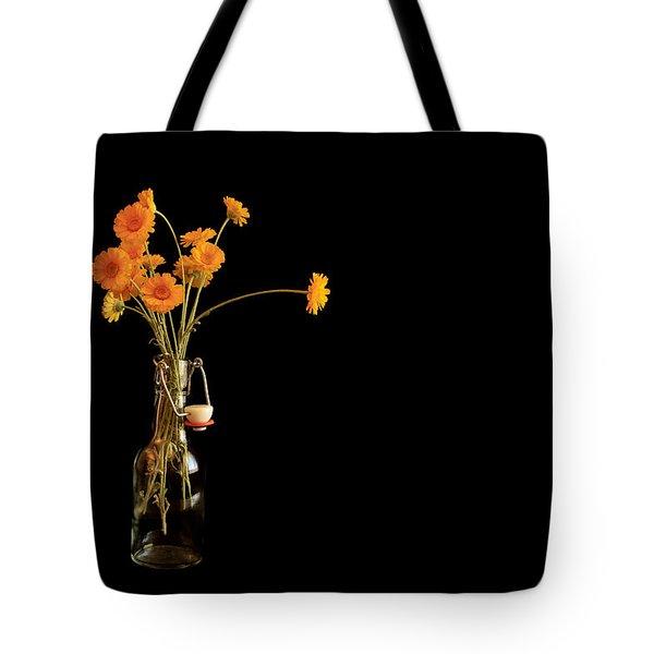 Orange Flowers On Black Background Tote Bag by Don Gradner
