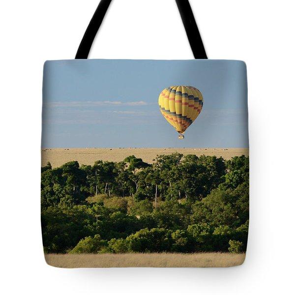 Tote Bag featuring the photograph Yellow Hot Air Balloon Masai Mara by Tom Wurl