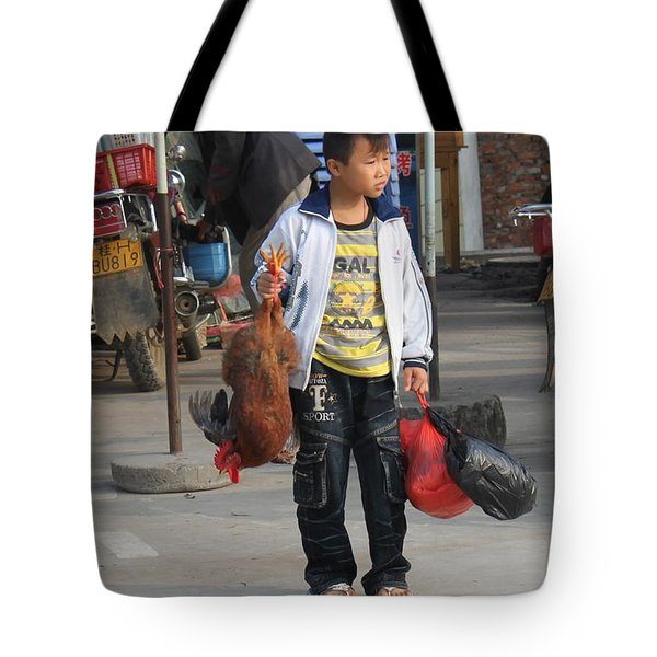 Young Boy Carrying A Dead Chicken To School Tote Bag