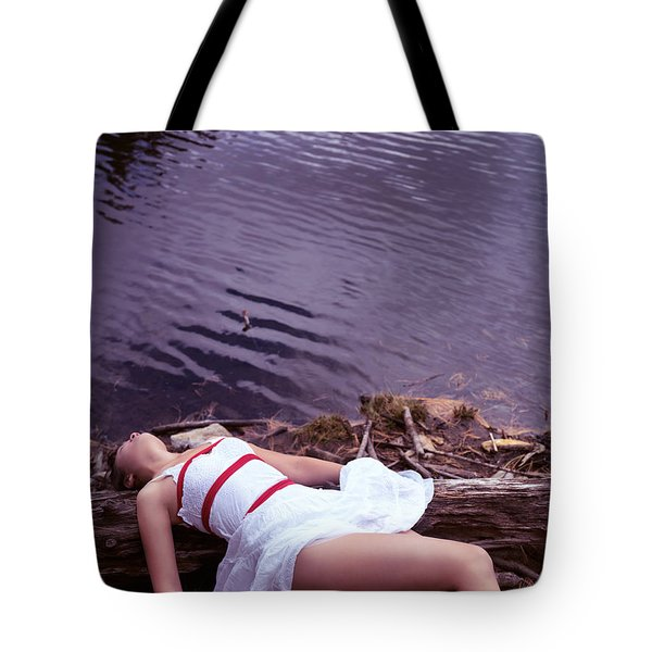Young Woman In Dress And Bondage Rope Lying Near Water Tote Bag