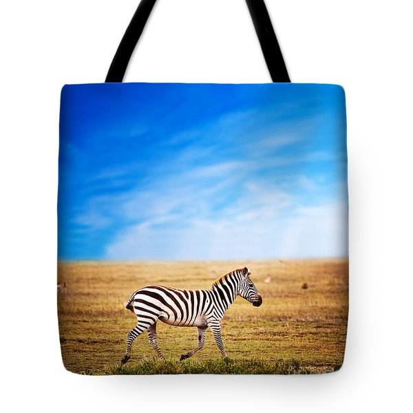 Zebra On African Savanna. Tote Bag by Michal Bednarek