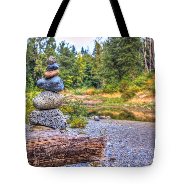 Tote Bag featuring the photograph Zen Balanced Stones On A Tree by Eti Reid