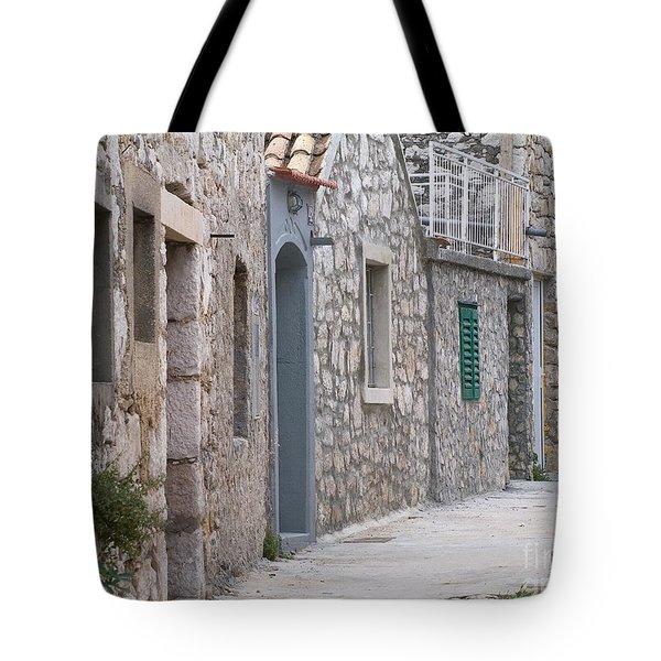 Tote Bag featuring the photograph  Street by Odon Czintos