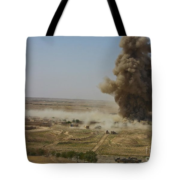 A Cloud Of Dust And Debris Rises Tote Bag by Stocktrek Images
