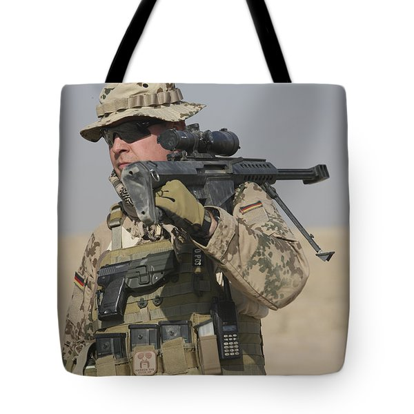 A German Soldier Carries A Barrett Tote Bag by Terry Moore