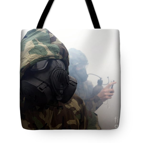 A Marine Wearing A Gas Mask Tote Bag by Stocktrek Images