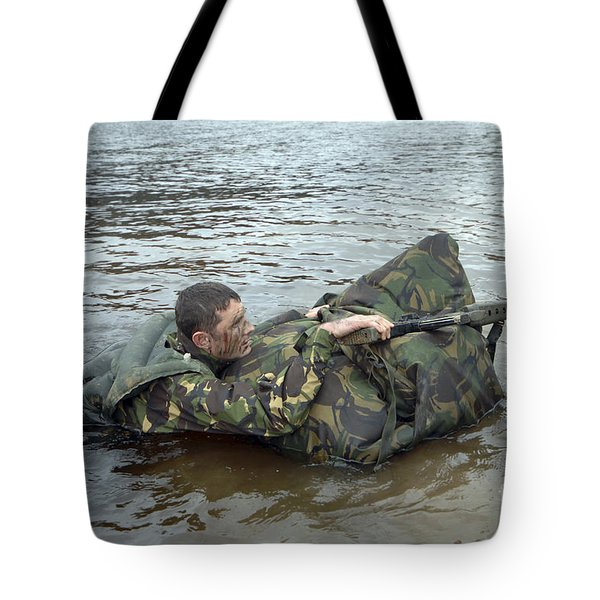 A Soldier Participates In A River Tote Bag by Andrew Chittock