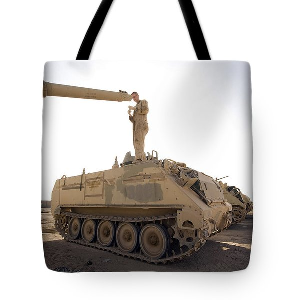 A Us Army Mechanic Uses A M113 Tote Bag by Terry Moore